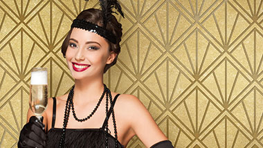 flapper holding champagne with a gold art deco background
